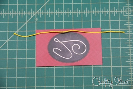 Cut a 6 piece and lay across business card