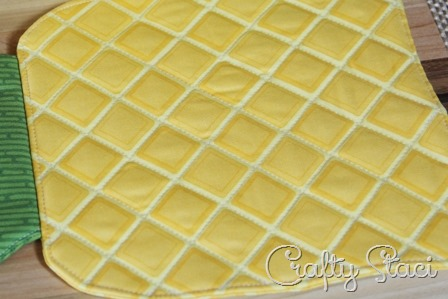 Diagonally quilting on pineapple hot pad