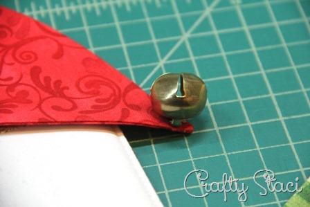 Attaching bell to hat